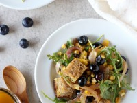 Recipe for blueberry corn panzanella. With multigrain bread cubes, fresh corn, blueberries & avocado. Vegan and simple to pull together!