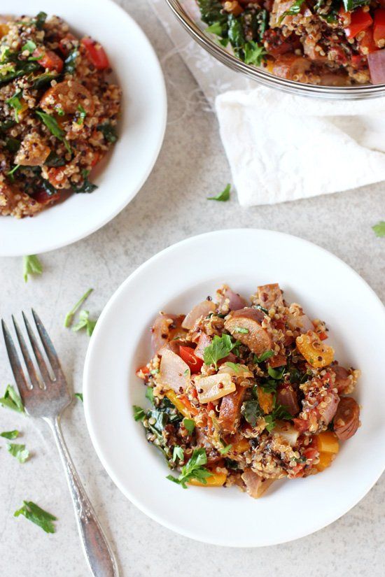 Two white plates filled with Cajun Quinoa.