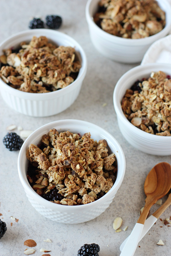 Recipe for individual blackberry and blueberry crisps. With a crunchy oat and nut topping. Refined sugar free and so fun for summer!