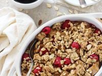 Recipe for overnight raspberry almond baked french toast. With whole wheat bread, fresh raspberries and an easy granola crumble topping!