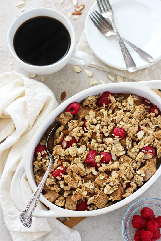 A white baking dish filled with Raspberry Almond Baked French Toast.