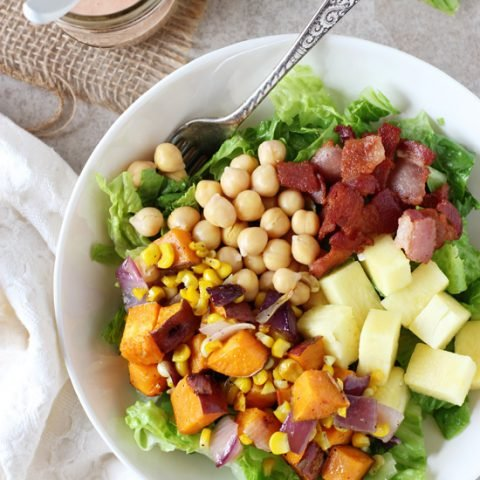 Recipe for sweet and salty BBQ sweet potato, chickpea and bacon salad. With roasted veggies, fresh pineapple, crispy bacon and a creamy BBQ sauce dressing!