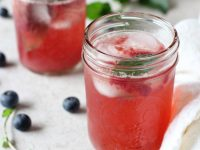 Recipe for blueberry mint sparkling lemonade. A fun summer treat! Refined sugar free and made with fresh blueberries!