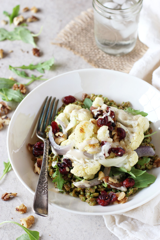 A white dish filled with Pesto Farro Bowls and a fork.