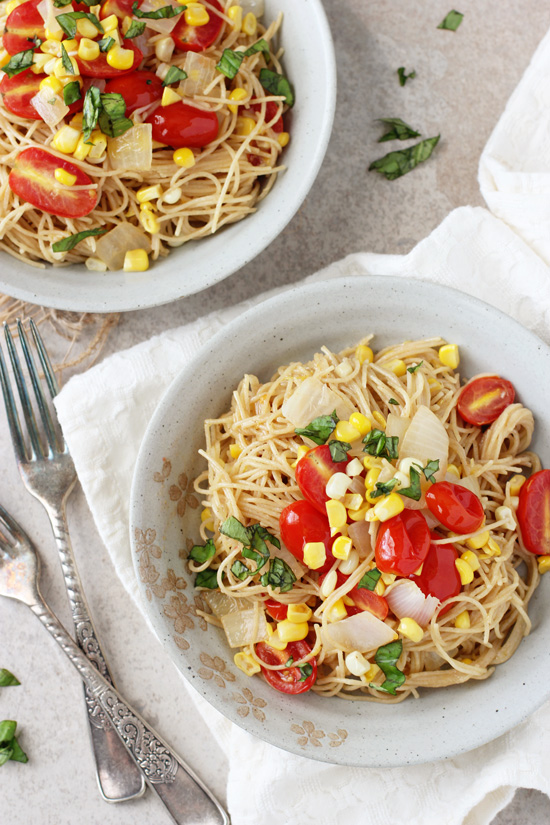 Two bowls filled with Tomato and Corn Angel Hair Pasta.