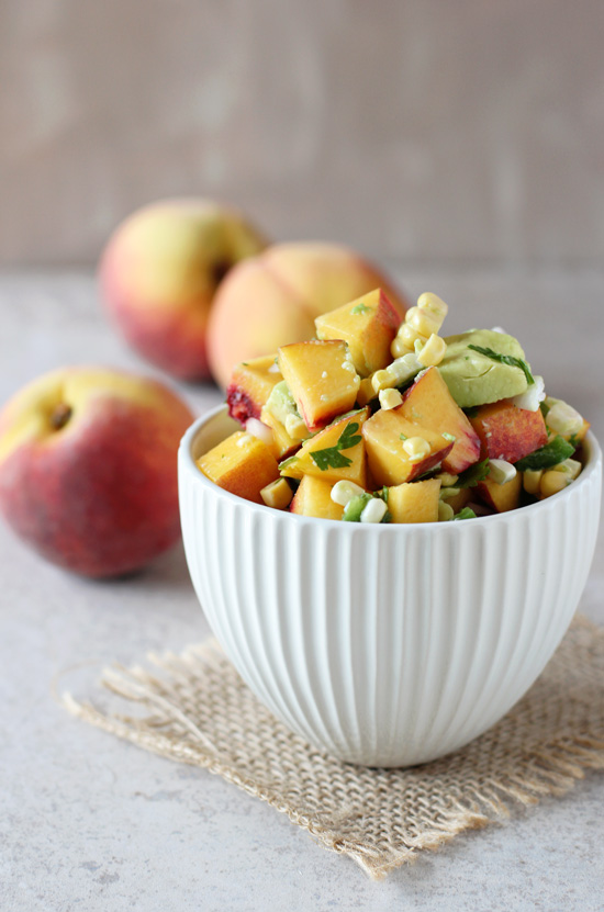 A white bowl filled with Peach Salsa.
