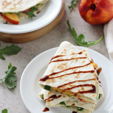 Recipe for quick & easy peach and white bean quesadillas. With a basil-packed white bean spread, fresh peaches, arugula and balsamic glaze!