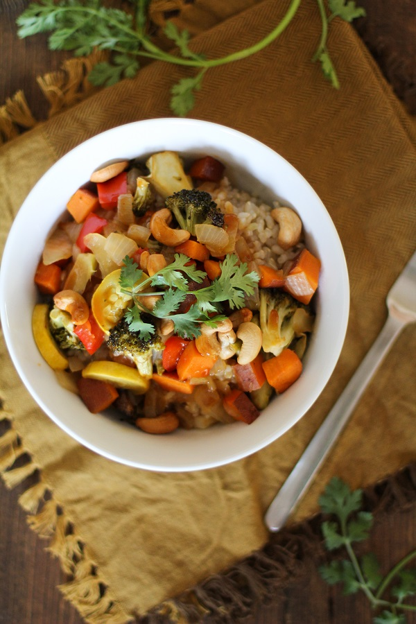 A white dish filled with Roasted Vegetable Teriyaki Bowls.