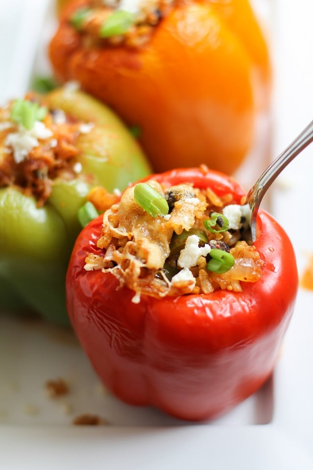 Three Southwest Stuffed Bell Peppers on a white platter.