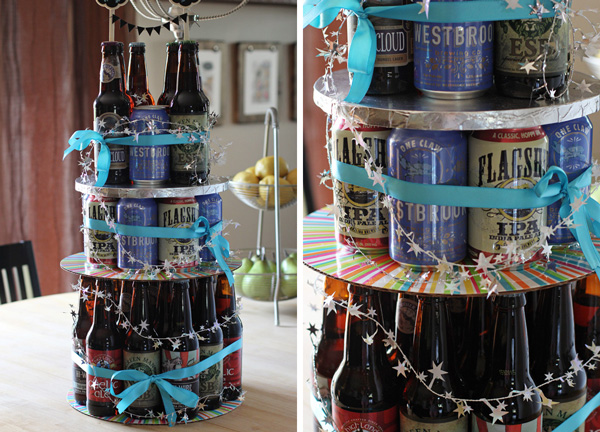"Beer bottles and cans stacked to form a ""cake."""