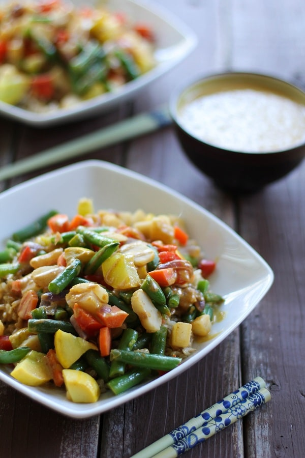 A white bowl filled with 6 Vegetable Stir Fry with Peanut Sauce.