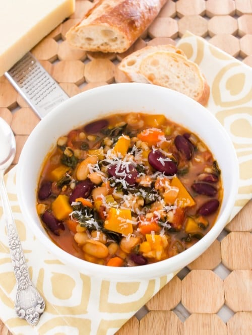 A white bowl filled with Autumn Minestrone.