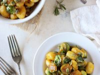 Recipe for pumpkin and brussels sprout gnocchi. With a creamy pumpkin sauce & pan-roasted sprouts! Have this cozy meal on the table in 35 minutes or less!