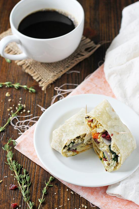 Recipe for freezer-friendly fall wild rice breakfast burritos. With eggs, plenty of veggies, cranberries, walnuts and a pumpkin sauce!