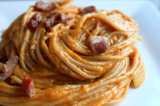 Butternut Squash, Bacon, and Gruyere Pasta on a white plate.