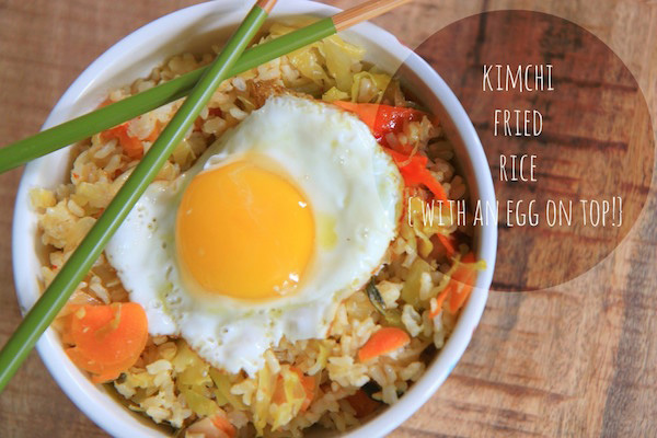 A white bowl filled with Kimchi Fried Rice.