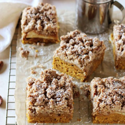 Recipe for a fall pumpkin apple crumb cake! With a soft pumpkin cake, sliced apples and a thick layer of crumbs! Made with coconut oil!
