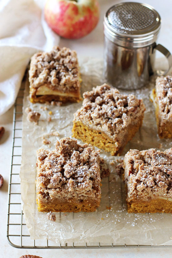 Slices of Pumpkin Apple Crumb Cake on a cooling rack.