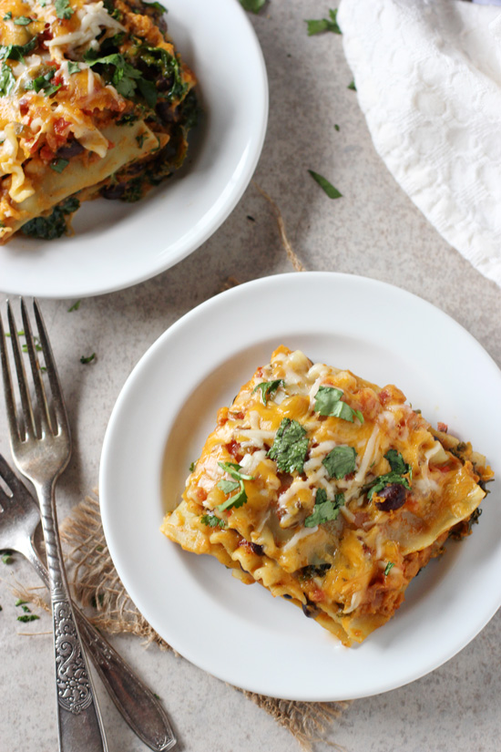 Easy sweet potato, black bean and kale lasagna! A mexican spin on lasagna with sweet potato puree, plenty of spices and cheese!