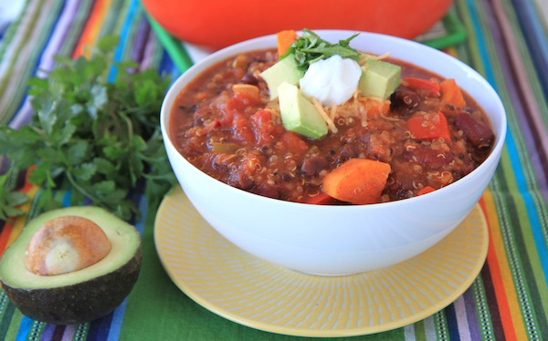A white bowl filled with Sweet Potato and Quinoa Chili.
