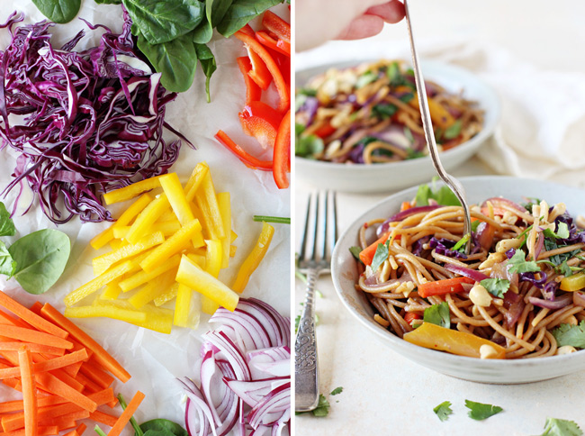 Sliced veggies on white parchment paper and a bowl of veggie lo mein with a fork.