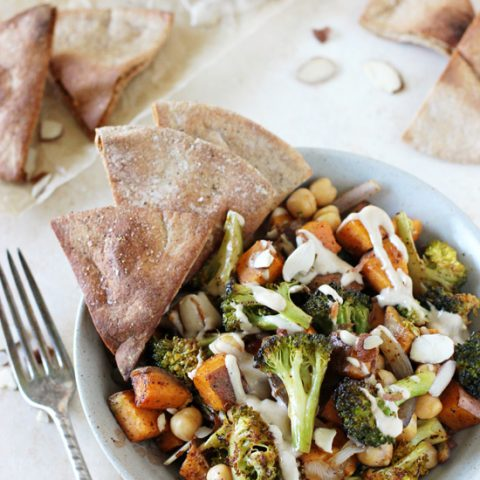Cozy and comforting, these roasted sweet potato, broccoli and chickpea bowls are a perfect healthy dinner recipe! With crunchy pita chips and a cinnamon tahini drizzle!