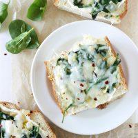 Spinach Artichoke French Bread Pizzas