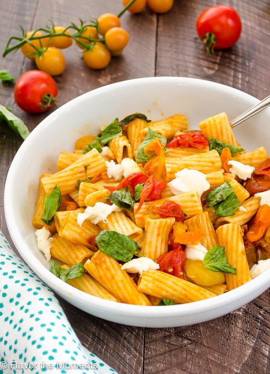 A white bowl filled with 30 Minute Caprese Skillet Pasta.