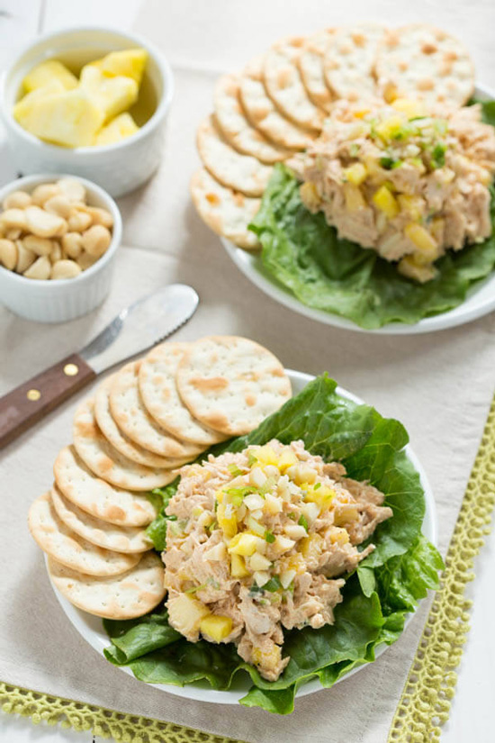Two plates with Hawaiian Chicken Salad, lettuce and crackers.