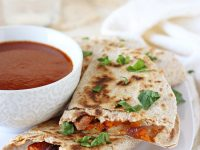 Plenty of veggies, spices, black beans and of course cheese make these roasted vegetable quesadillas a weeknight staple! A simple vegetarian recipe that can double as an appetizer!
