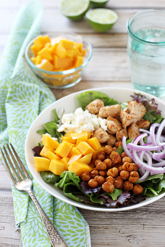 A white bowl filled with Chicken, Chickpea and Mango Salad.