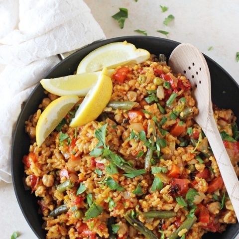 A simple, stovetop recipe for vegetable paella! A vegetarian take on this classic Spanish dish! On the table in under one hour!