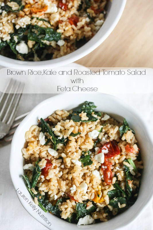 Two white bowls filled with Brown Rice Kale and Roasted Tomatoes.