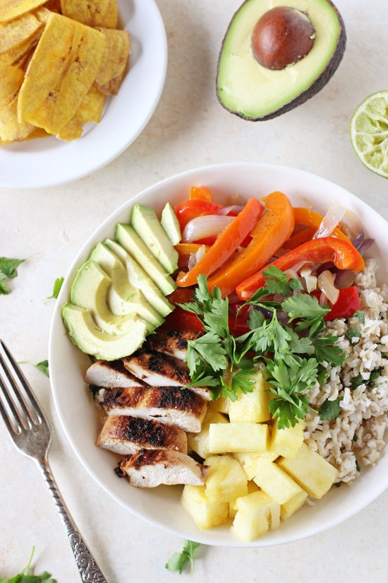 Tropical & bright caribbean chicken bowls! This recipe is filled with creamy coconut rice, crisp colorful veggies and juicy citrus chicken!