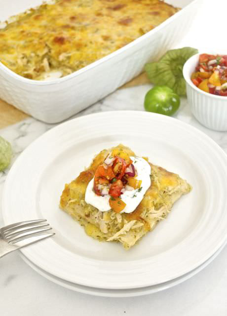 A white plate with a piece of Chicken Verde Enchilada Bake.