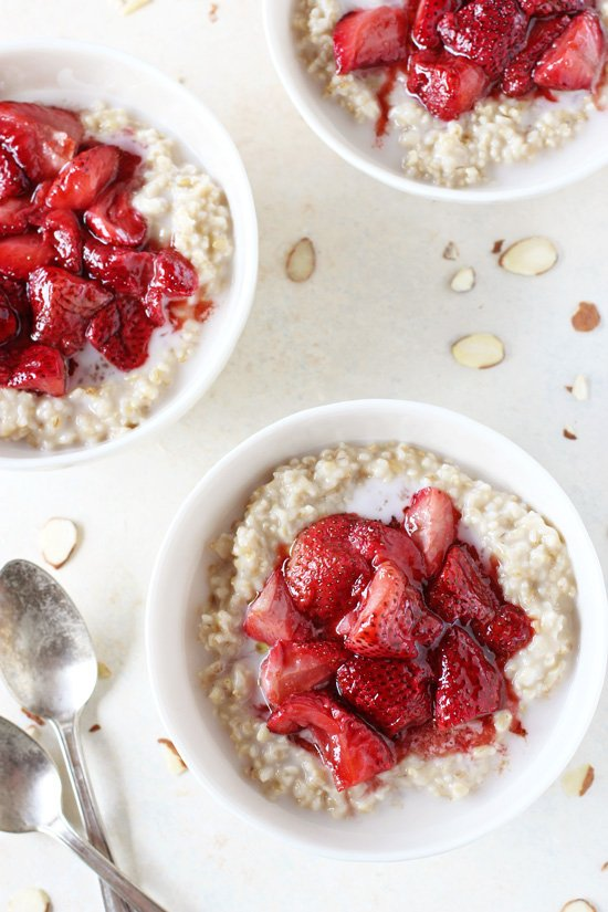 Three white bowls filled with Strawberries and Cream Steel Cut Oatmeal.