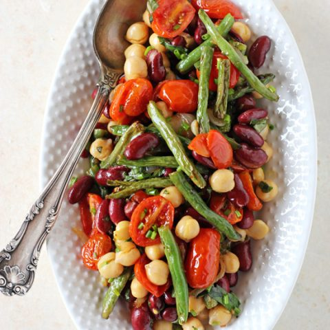 A simple & satisfying three bean salad! Filled with roasted green beans and tomatoes! Finished with fresh herbs and a delightful honey mustard dressing!