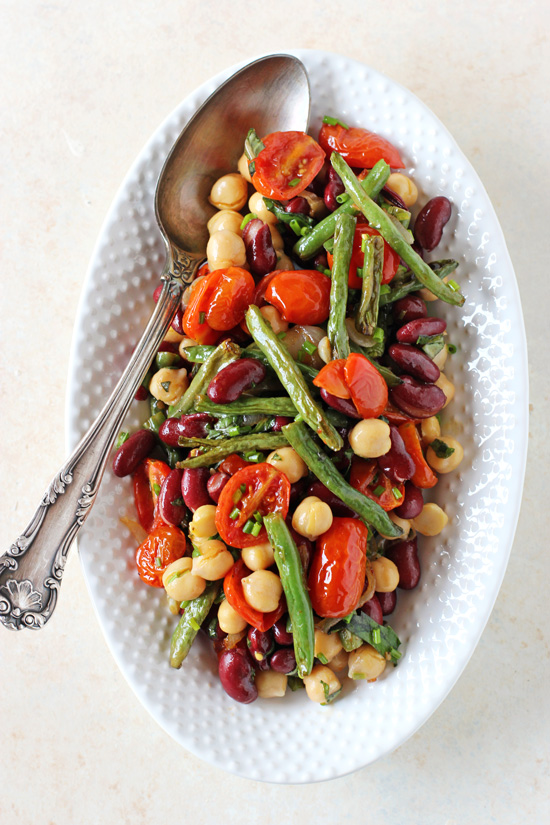 A white serving platter filled with Roasted Three Bean Salad.