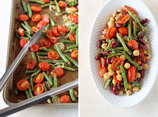 A tray of roasted tomatoes and green beans, plus a white serving platter filled with Three Bean Salad.