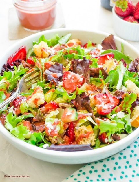 A large white bowl filled with Strawberry Fields Panzanella Salad.