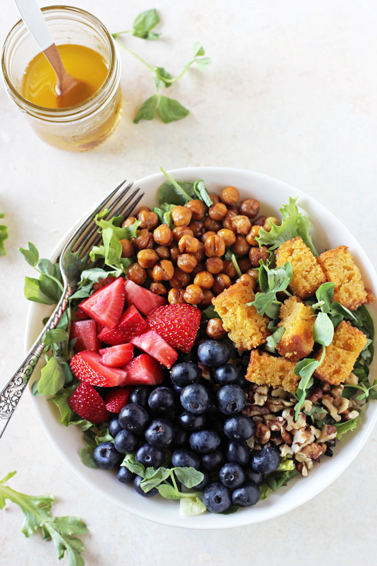 Filled with strawberries, blueberries and spinach, this summer berry chopped salad is perfect for warm weather! Topped with bacon (or chickpea bacon!) and a honey lemon dressing!