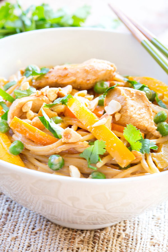 A white bowl filled with Thai Peanut Chicken Noodles.