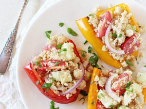Easy and healthy vegetarian greek stuffed peppers! Filled with tomatoes, cucumber, red onion and feta! Light and packed with freshness!