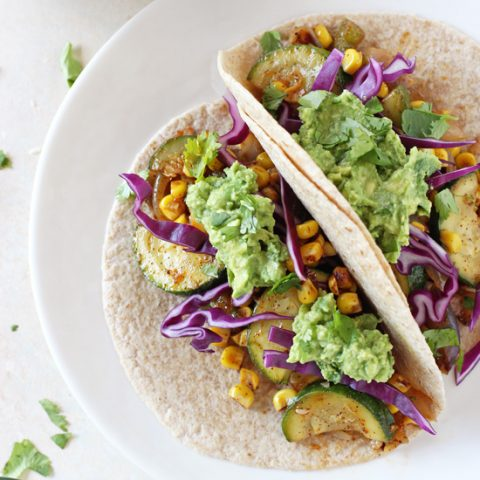 Just 30 minutes to these healthy and flavorful zucchini and corn tacos! With fresh corn, chili powder and a simple homemade guacamole!