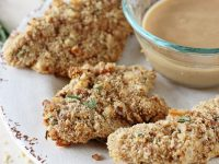 Healthy and juicy baked rosemary walnut chicken tenders! With a walnut & fresh rosemary breadcrumb crust and a creamy honey mustard dipping sauce!
