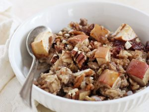 Warm and cozy spiced cranberry apple baked oatmeal! A great make-ahead breakfast! Naturally sweetened and filled with fresh apples, dried cranberries and pecans!