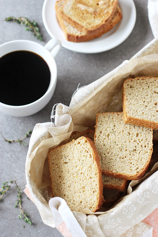 A bread basked filled with slices of Lemon Thyme English Muffin Bread.