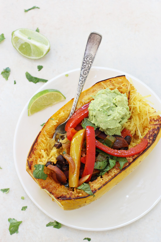 A Fajita Stuffed Spaghetti Squash on a white plate with a fork.