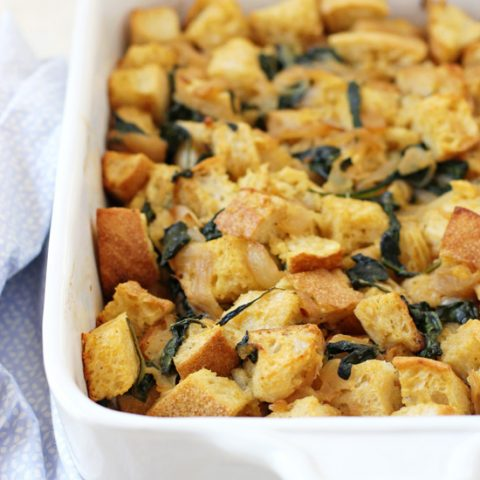 Cozy caramelized onion and spinach stuffing! With sourdough bread and oh-so-flavorful caramelized onions. A fun twist on classic stuffing for the holidays!