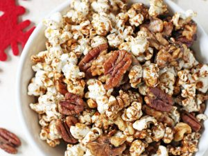 This easy sweet & spicy popcorn nut party mix is completely addicting! Made with fresh rosemary, warm spices and maple syrup!